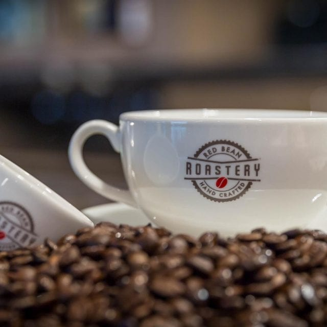 2 cups and coffee beans at Red Bean Roastery